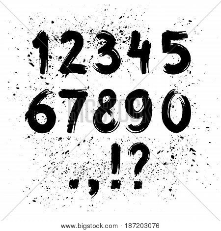 Hand written calligraphy alphabet black ink brush lettering numbers and punctuation marks grunge font style with ink splashes. Vector