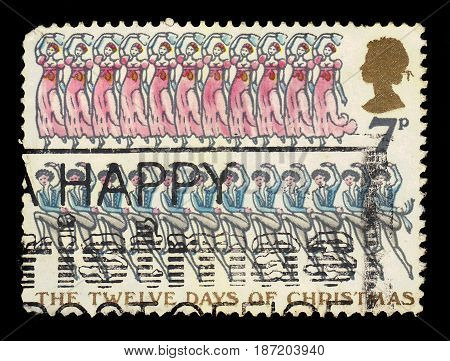 UNITED KINGDOM - CIRCA 1977: A stamp printed in UK shows Twelve Lords a-leaping, Eleven Ladies dancing, with inscriptions and name of series