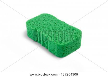 High angle view of green bath sponge against white background