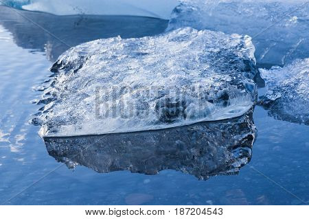 Close up Ice breaking in winter season lagoon Iceland natural landscape background