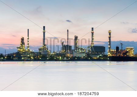 Refinery river front night view industrial background