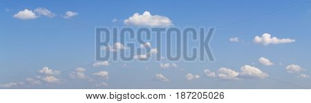 Blue summer sky with white fluffy clouds panoramic view heaven template for design purposes