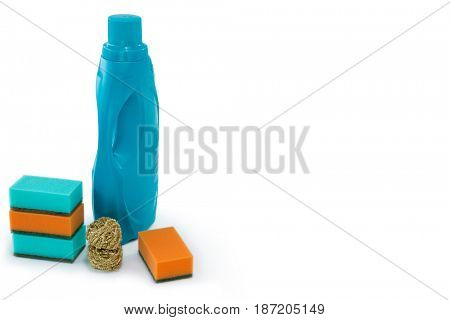 Bottle with cleaning sponges over white background