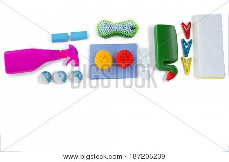 Overhead view of cleaning products over white background