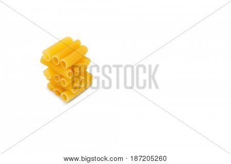 Close up of stacked rigatoni against white background