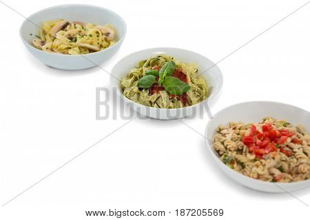 High angle view of pastas served in containers against white background
