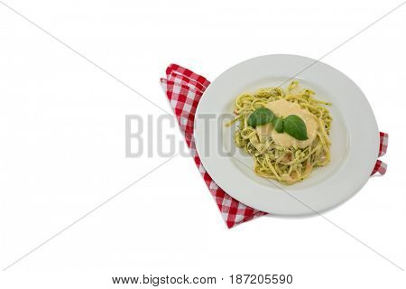 High angle view of pasta served with sauce in plate on napkin against white background