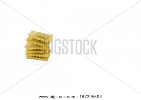 Close up of stacked ravioli against white background