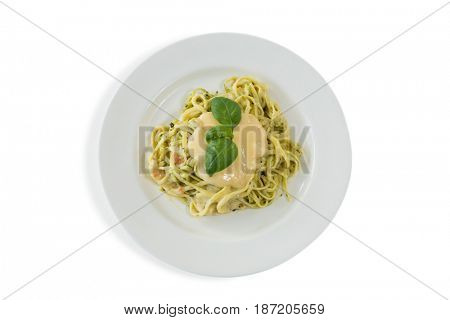 Overhead view of fettuccine served in plate over white background