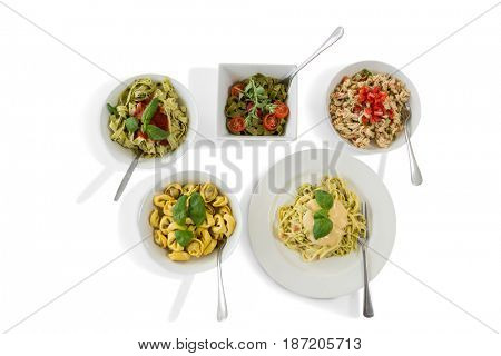 Various pasta served in containers over white background