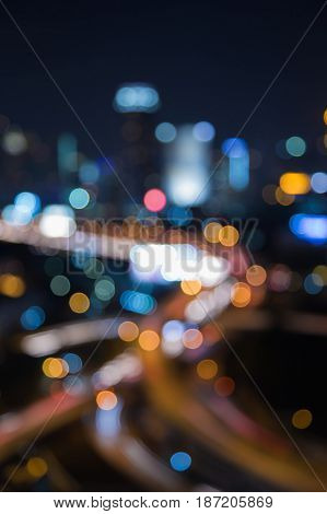 Blurred light night view city and highway interchanged abstract background