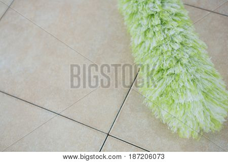 Close up of duster on tiled floor
