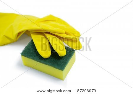 High angle view of glove and sponge against white background
