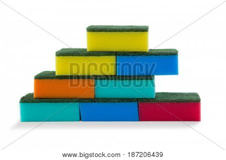 Close up of stacked colorful sponges against white background