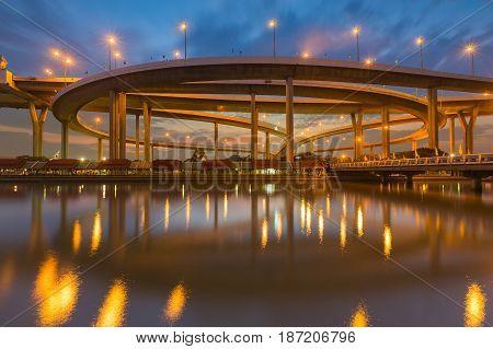 Twilight sky over Highway interchange river front transportation background