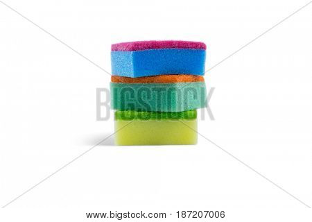 Close up of colorful sponge stacked against white background