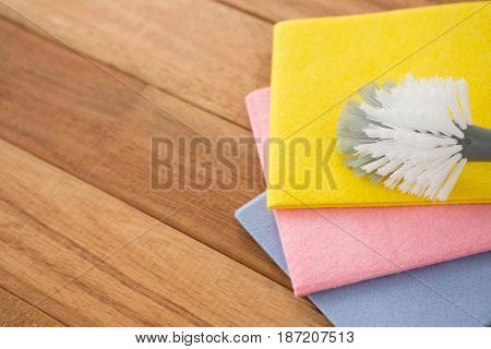 High angle view of brush with wipe pads on wooden table