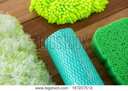 Close up of sponges on wooden table