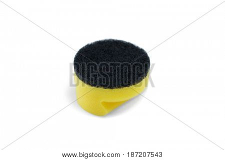 Close up of black cleaning sponge against white background