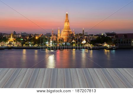 Opening wooden floor Arun temple Thailand landmark with beauty of after sunset sky background Bangkok Thailand