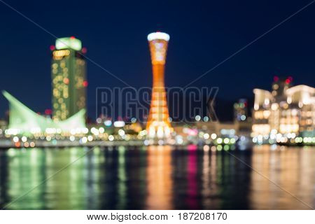 Abstract blurred twilight night view Kobe port tower with water reflection abstract background Japan