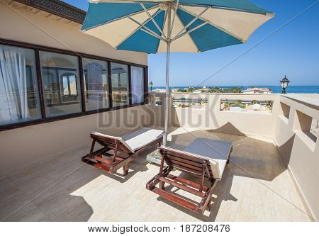 Roof Terrace With Sun Beds In Luxury Apartment