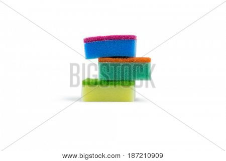 Stack of colorful sponge against white background
