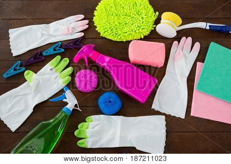 High angle view of cleaning products on wooden table