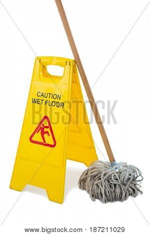 Close up of wet floor sigh board with mop against white background