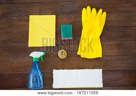 Overhead view of cleaning products on wooden table