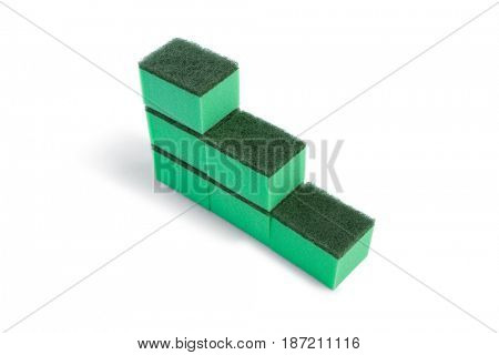 High angle view of cleaning sponge arranged in stack against white background
