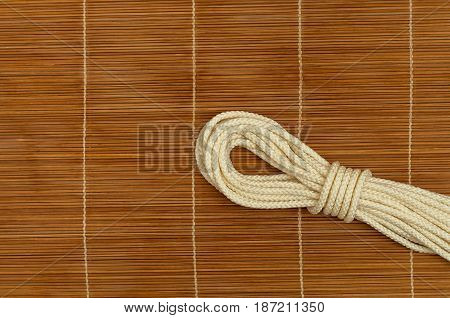 Folded  white rope on a wooden background