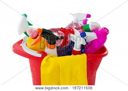 Close up of cleaning products in bucket against white background