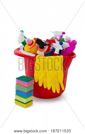 Sponge by cleaning equpment in bucket against white background