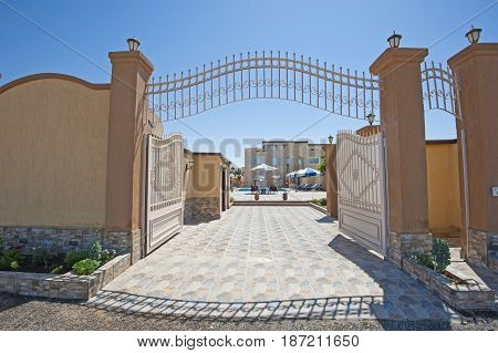 Large Metal Gated Entrance To Luxury Tropical Villa