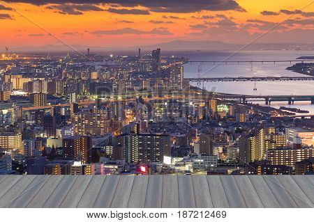 Opening wooden floor Umeda sky building top view of Osaka city downtown with sunset sky background