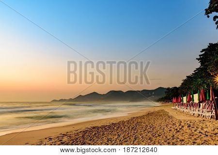 ChawengBeach in the morning seaside landscape ChawengBeach is a famous beach in Samui Island, southern of Thailand. Seaside landscape with the sunrise sky, colorful umbrellas, white beach chairs and long creative footprints sand is very beautiful. Looking