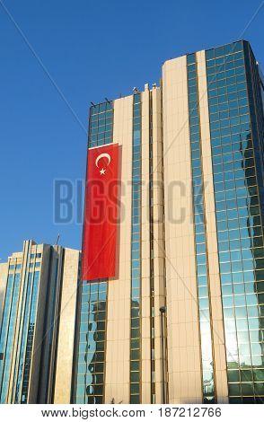 ISTANBUL, TURKEY - MAY 20, 2016: Modern skyscraper with a turkish flag in iSTANBUL Cevre Yolu Avenue. istanbul city,  Turkey