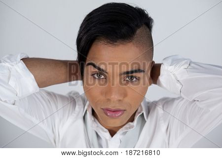 Close up portrait of transgender woman against white background