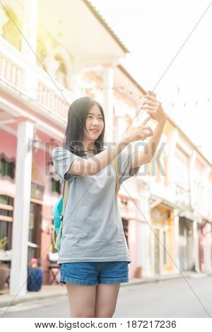 Young Asian Traveling Blogger Or Backpacker Using Route Application On The Mobile Phone  To Find The