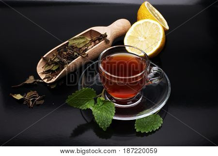 Tea. Herbal Tea. Mint Leaf. Tea In A Glass Cup, Mint Leaves, Dried Tea, Sliced Lime. Herbs On A Slat