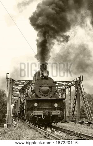 Old locomotive on the railway steam locomotive outdoors retro style old photo