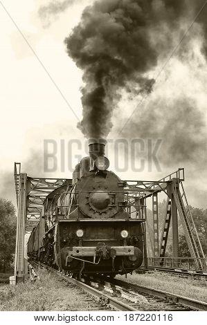 Old locomotive on the railway steam locomotive outdoors retro style old photo