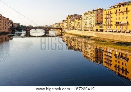 Santa Trinita bridge and Acciaiuoli embankment (Lungarno) in the late afternoon sun - Florence Tuscany Italy