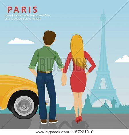 Young couple holding hands standing next to a yellow car looking at Eiffel Tower in Paris