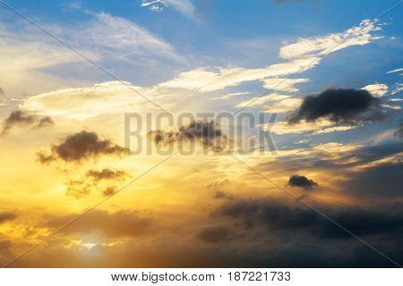 Cumulus sunset clouds with sun setting down sky clouds sun