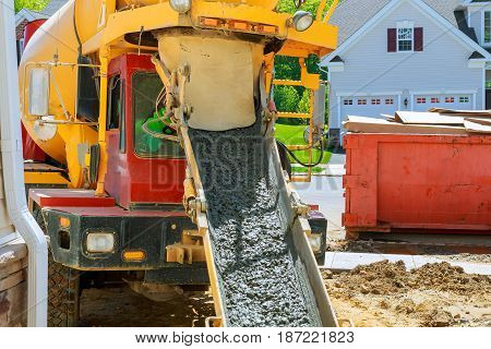 Wheelbarrow with shovel full of cement Concrete wheelbarrow
