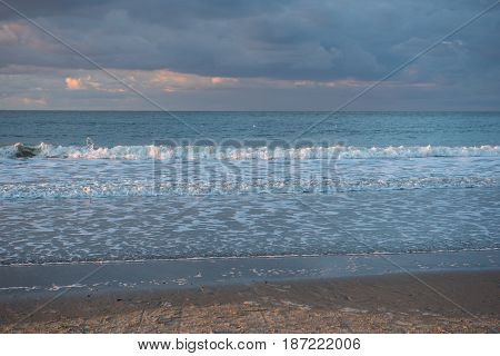 Catching thunderstorm over the North Sea beach of Cadzand Holland