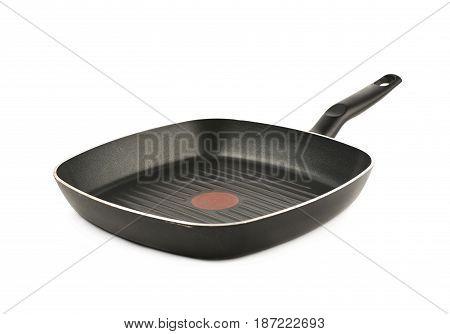 Ribbed and square shaped grill pan with a temperature indicator isolated over the white background