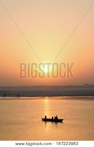 VARANASI, INDIA - May 7, 2017 : Tourists on wooden boats at Ganges river in Varanasi India taken on May 7, 2017 at Varanasi, India. Boat ride at Ganges river is famous travel activity in Varanasi